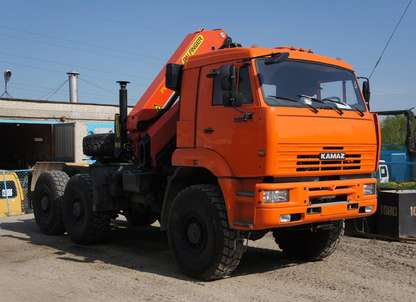 Седельный тягач КАМАЗ 65221 с КМУ