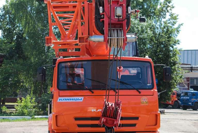 Автокран КС-55713-1К-4В (ОВОИД) на шасси КАМАЗ-65115